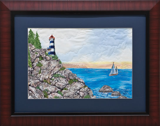 lighthouse and rocky coast art quilt