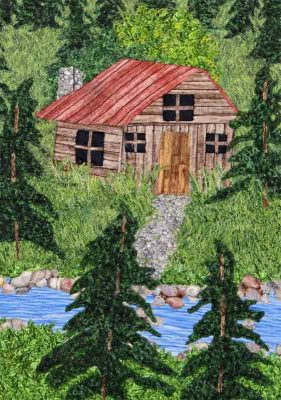 Art quilt with cabin, mountains and lake by Joyce R. Becker