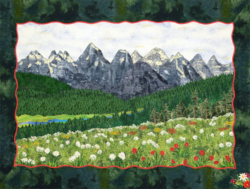 landscape art quilt with mountains and flowers