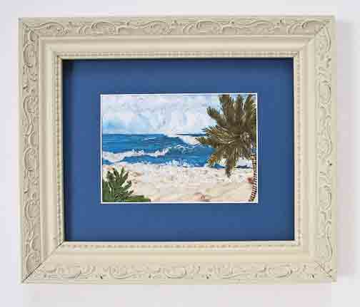 Beach and palm tree in an art quilt
