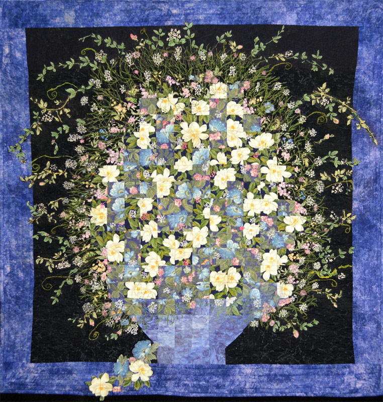 Watercolor quilt with applique of flowers