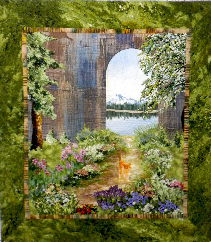Landscape quilt with cat, by Joyce R. Becker