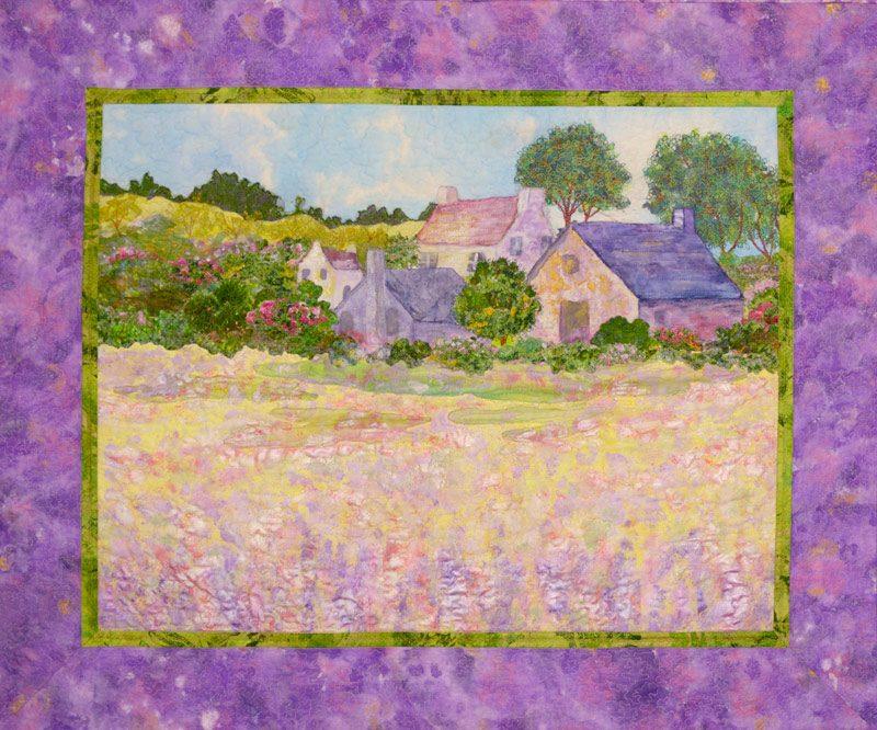 landscape art quilt of a garden scene and village