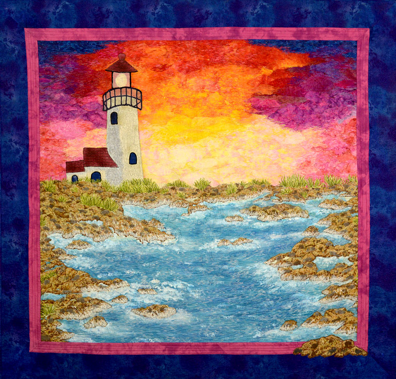 Lighthouse sunset art quilt by Joyce R. Becker