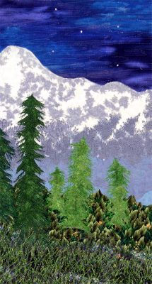 detail of art quilt with mountains and trees