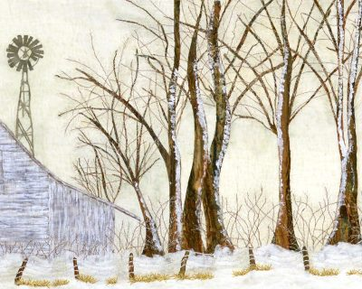 snow scene art quilt with barn and windmill